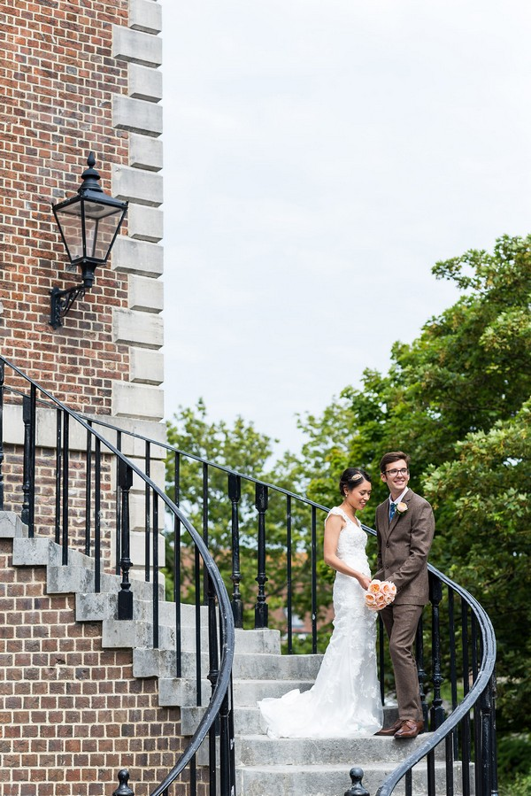 Bride and groom on steps of Poole Guildhall