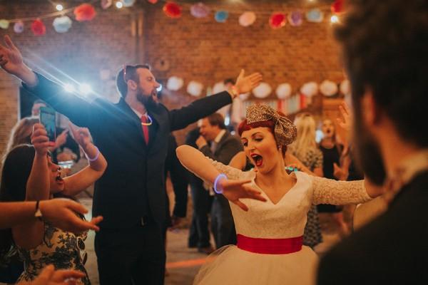 Bride and guests dancing having fun