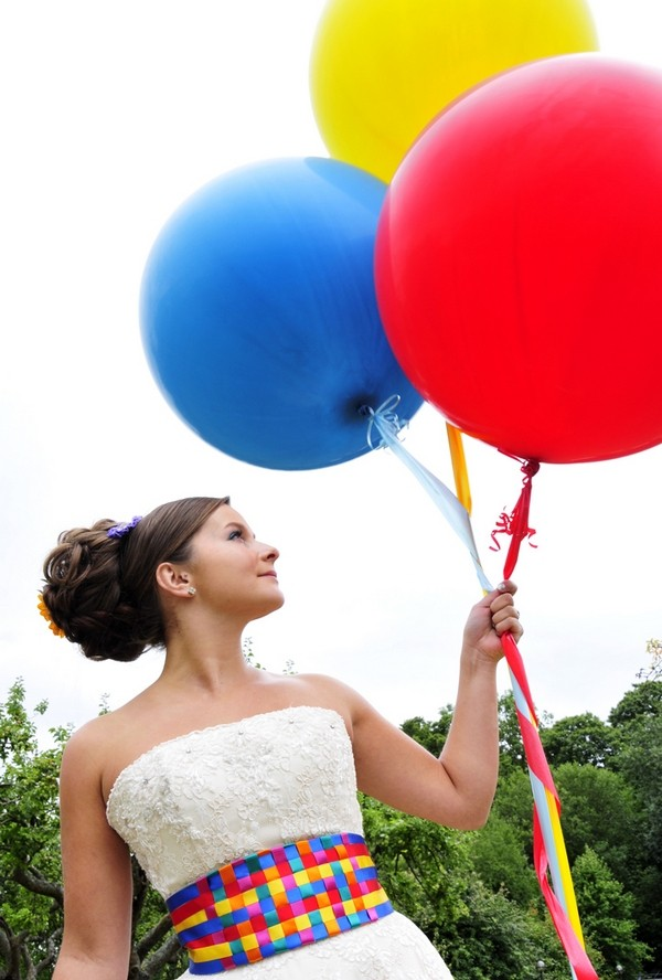 Bride Holding Colourful Balloons