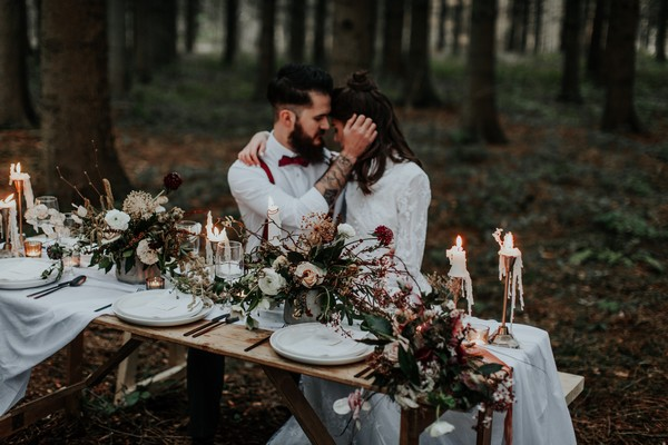 Couple sitting at naturally styled wedding table