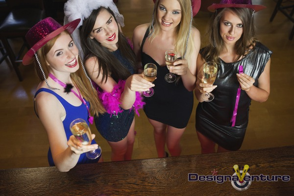 Ladies on hen party with glasses of champagne