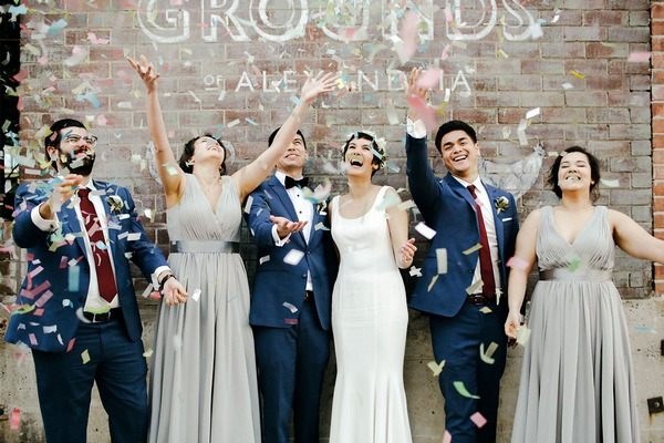 Bridal party throwing confetti in the air
