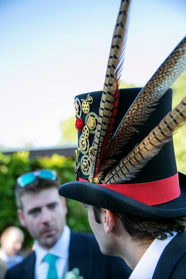 Wedding Guest Wearing Top Hat with Feathers