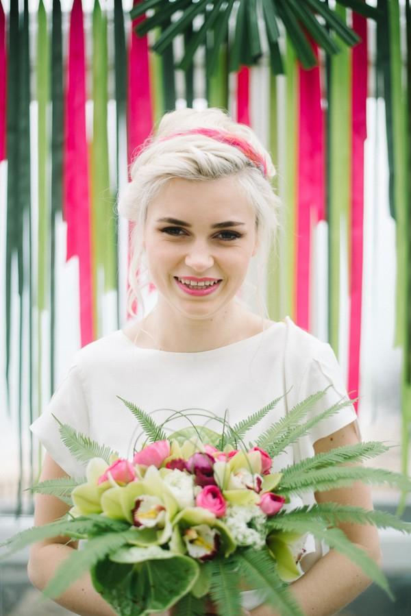Bride holding colourful bouquet