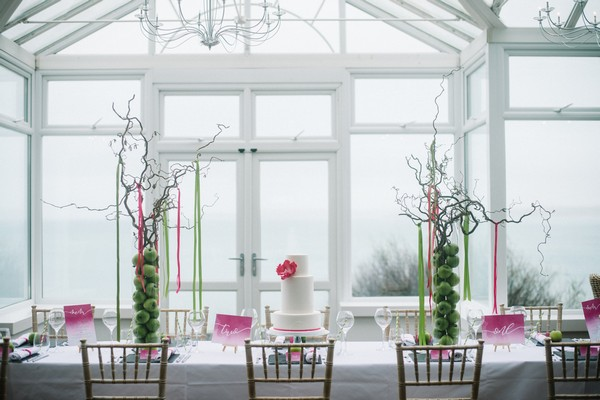 Wedding table with pink and green styling