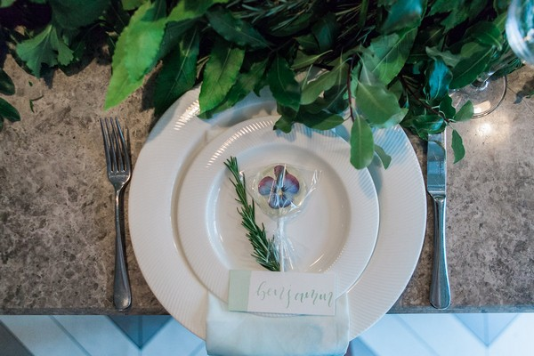 Wedding place setting with sprig of Rosemary