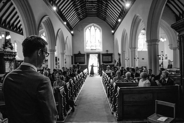 Groom waiting for bride inside St Nicholas church in Chislehurst