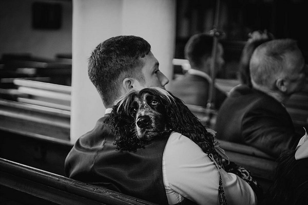 Dog resting head on owner's shoulder
