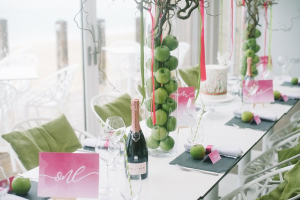 Pink and green details on wedding table