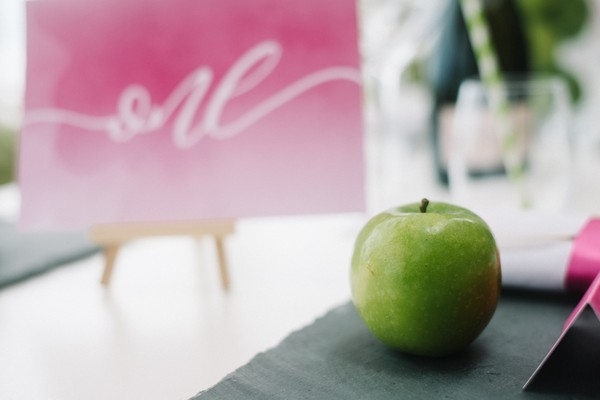 Green apple at wedding place setting