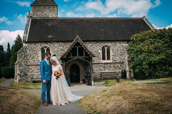 Bride and groom outside St Nicholas church in Chislehurst