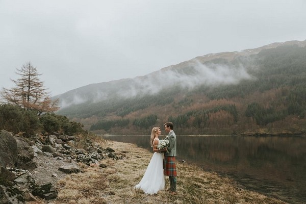 Bride and groom by loch - Picture by McKinley-Rodgers Photography