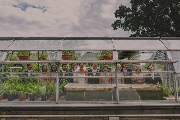 Bridal party standing in greenhouse - Picture by Lottie Elizabeth Photography