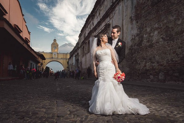 Bride and groom on street in Antigua, Guatemala