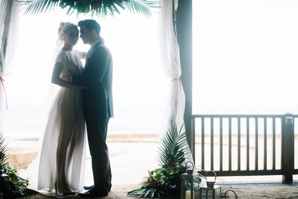 Bride and groom in beach hut