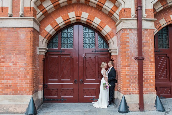 Bride and groom in large doorway