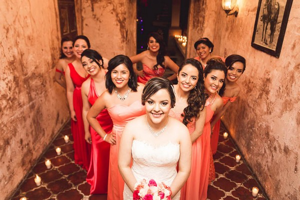 Bride and bridesmaids standing in a V shape