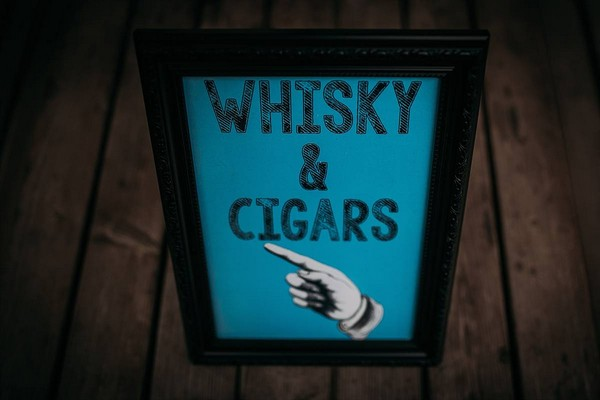 Whisky and cigars sign