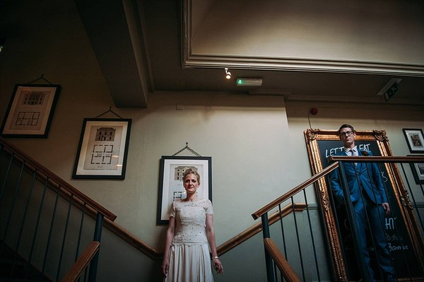 Bride and groom on stairs at The Bickley