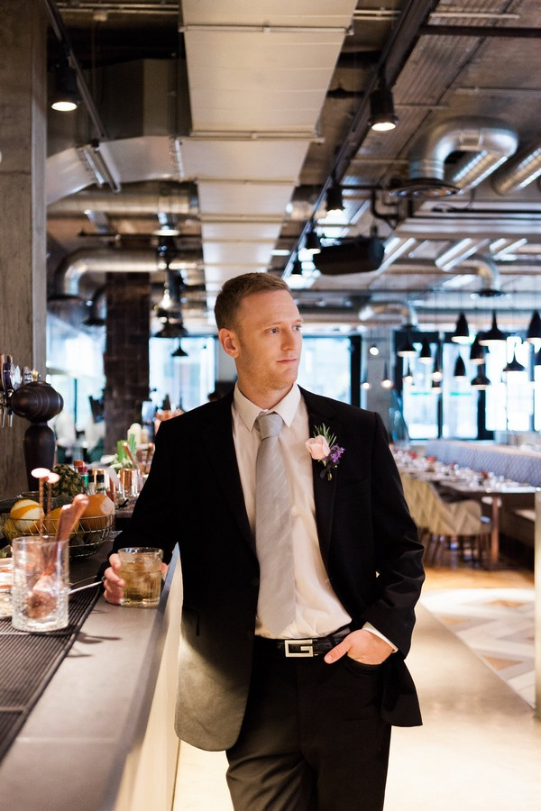 Groom in bar at Drake and Morgan at King's Cross