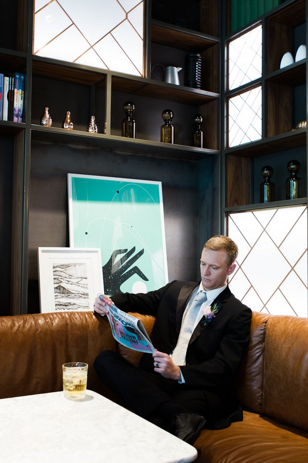 Groom reading newspaper