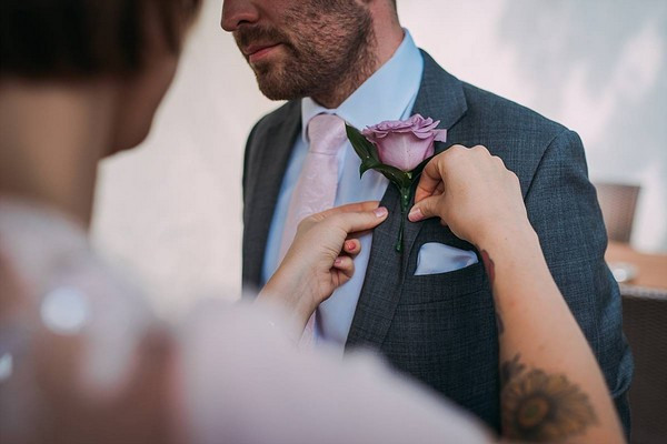 Buttonhole being pinned to suit