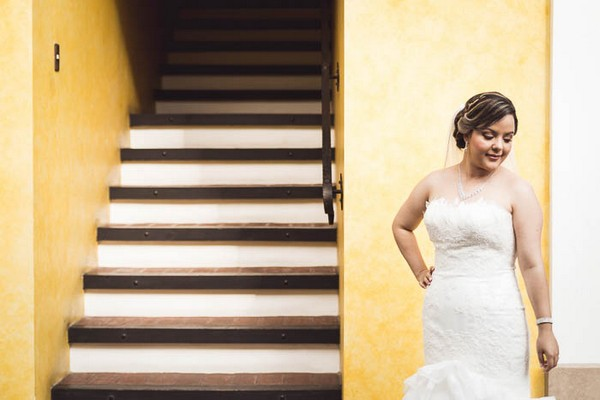 Bride standing by stairwell