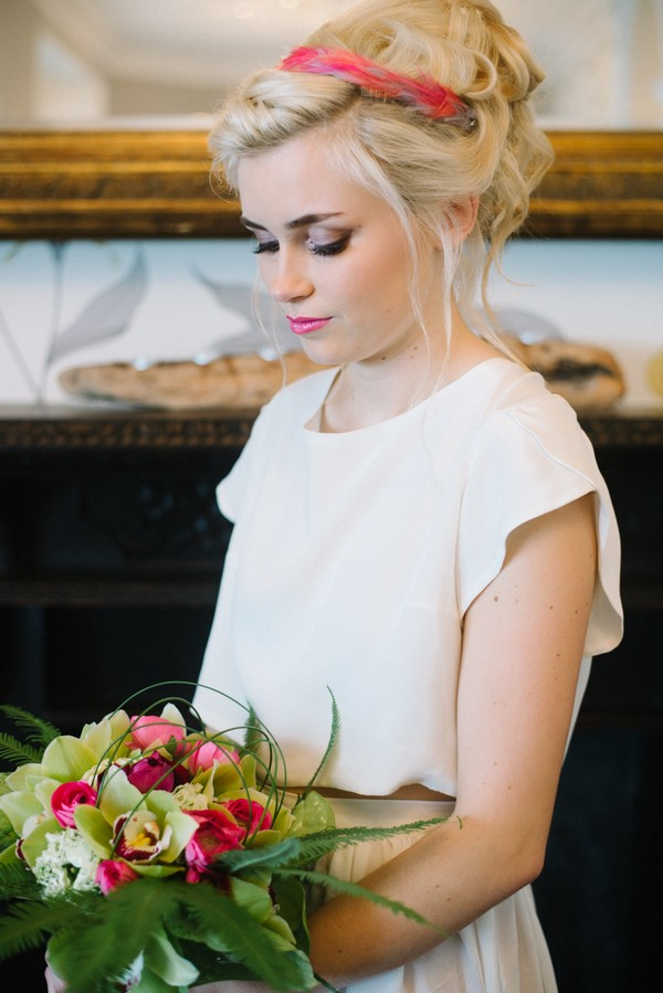 Bride looking down at bouquet