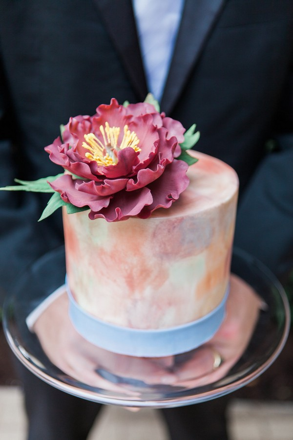 Flower on top of watercolour wedding cake