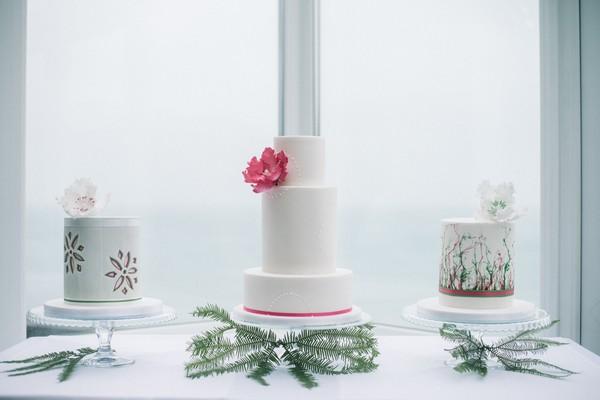 Three wedding cakes on table