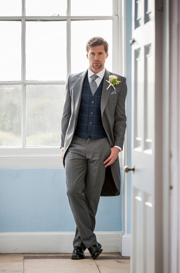 Groom in Mismatched Outfit of Blue Tailcoat and Grey Tweed Check Waistcoat