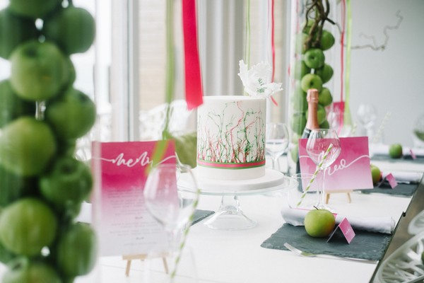 Cerise pink and green wedding table styling