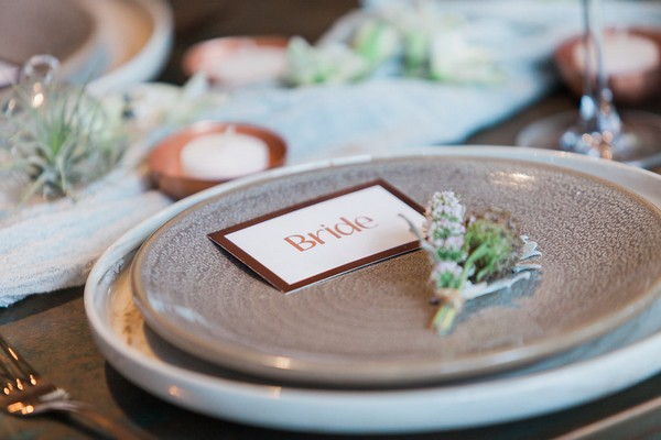Copper bride name card on plate
