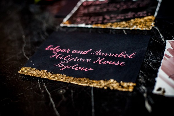 Black and gold wedding stationery