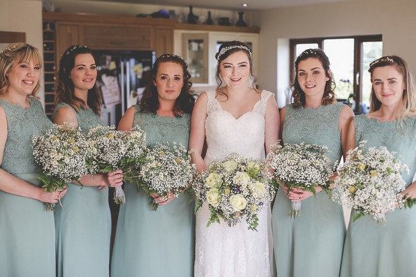 Bride with bridesmaids in pastel green dresses
