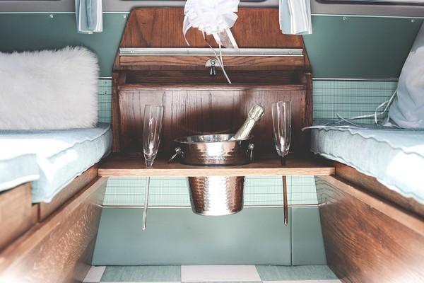Champagne bucket and glasses inside VW camper van
