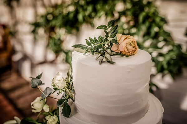 Single flower on top of wedding cake