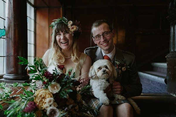 Bride and groom sitting with dog on groom's lap - Picture by Rooftop Mosaic