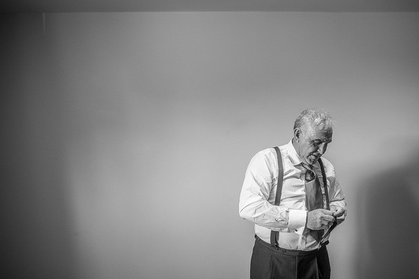 Elderly man adjusting braces before wedding - Picture by Damien Vickers Photography