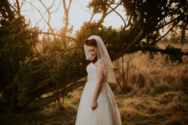 Bride standing by tree - Picture by Craig Williams Photography