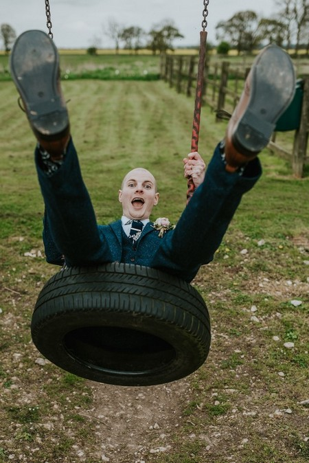 Groom on tyre swing - Picture by Daniel Ackerley Photography