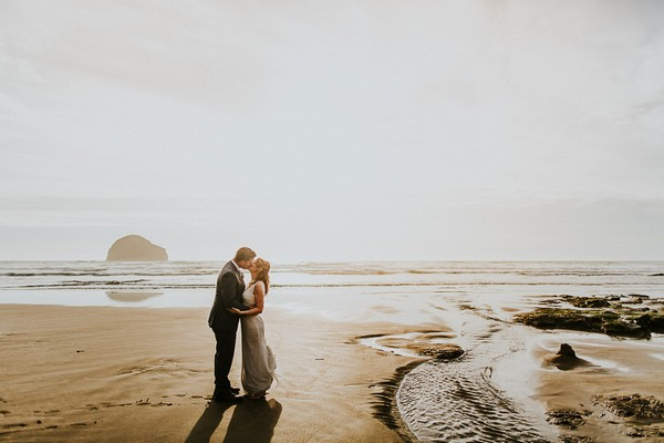 Bride and groom kissing on beach - Picture by Dan Ward Photography
