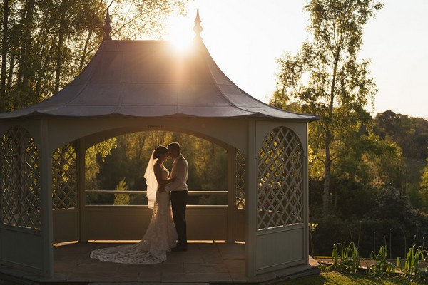 Bride and groom in gazebo at wedding venue - Picture by Penny Young Photography