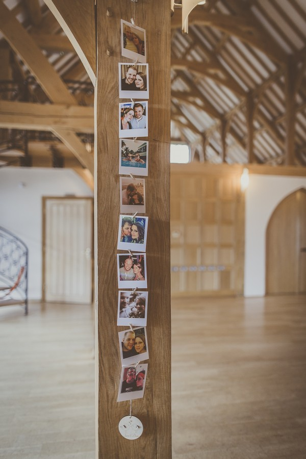 Pictures of couple hanging on beam