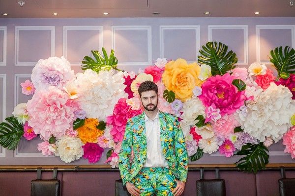 Groom wearing bright tropical style suit
