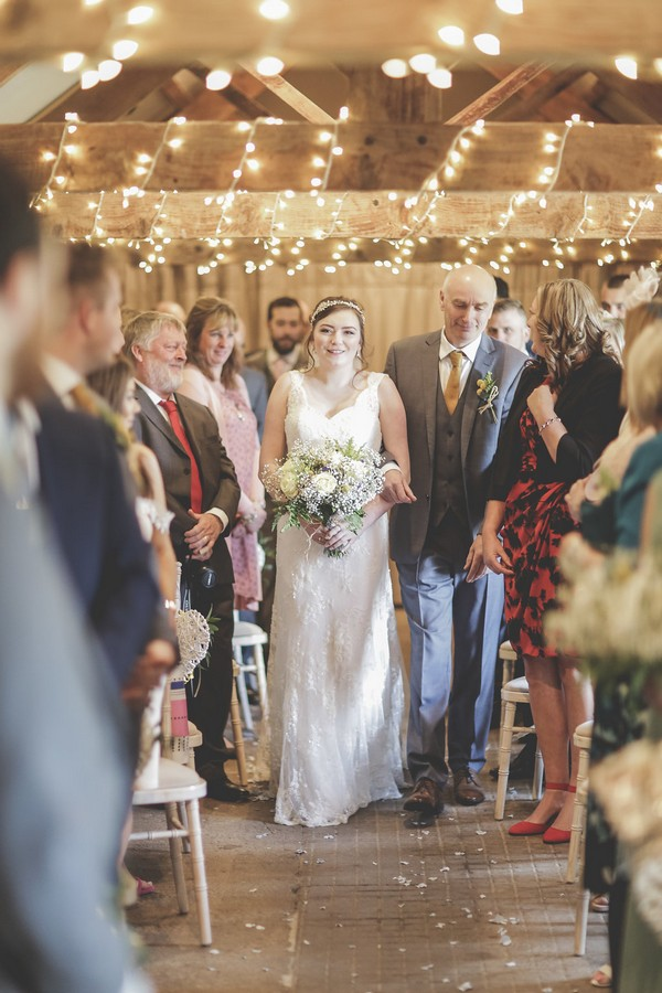 Bride walking down the aisle at Quantock Lakes wedding