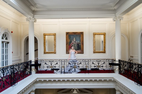 Bride on gallery at Hedsor House