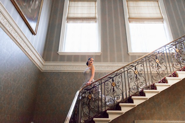 Bride walking down stairs at Hedsor House