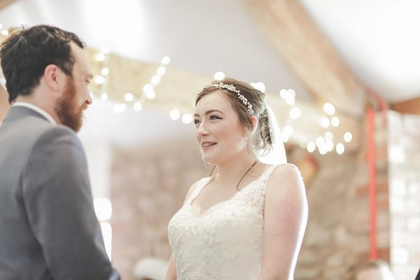 Bride and groom facing each other during wedding ceremony