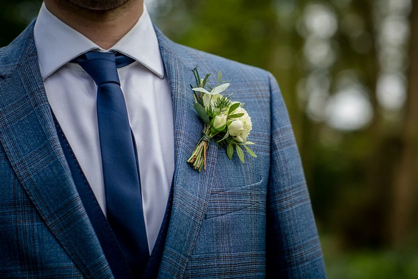 Buttonhole on groom's blue checked suit
